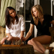 Sexy girls playing chess — Stock Photo