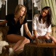 Sexy girls playing chess — Stock Photo #15878697