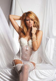 Young and sexy redhead woman in white lingerie — Stock Photo
