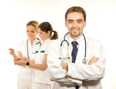 Team of young and smart medical workers isolated on white — Stock Photo