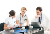 Group of medical workers discussing in office — Foto de Stock