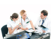 Group of medical workers discussing in office — Stock Photo