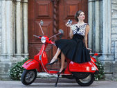 Young attractive girl with a scooter — Stockfoto