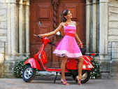 Young attractive girl with a scooter — Stock Photo