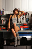 Young and sexy woman in garage — Stock Photo
