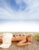 Young naked woman in spa isolated on white — Stock Photo
