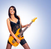 Sexy brunette with the guitar — Stock Photo