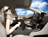 Sexy woman in a car — Stock Photo