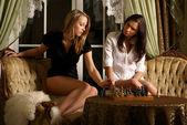 Sexy girls playing chess — Stock Photo