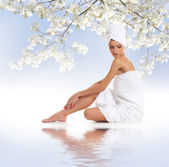 Young attractive woman getting spa treatment isolated on white — Stock Photo