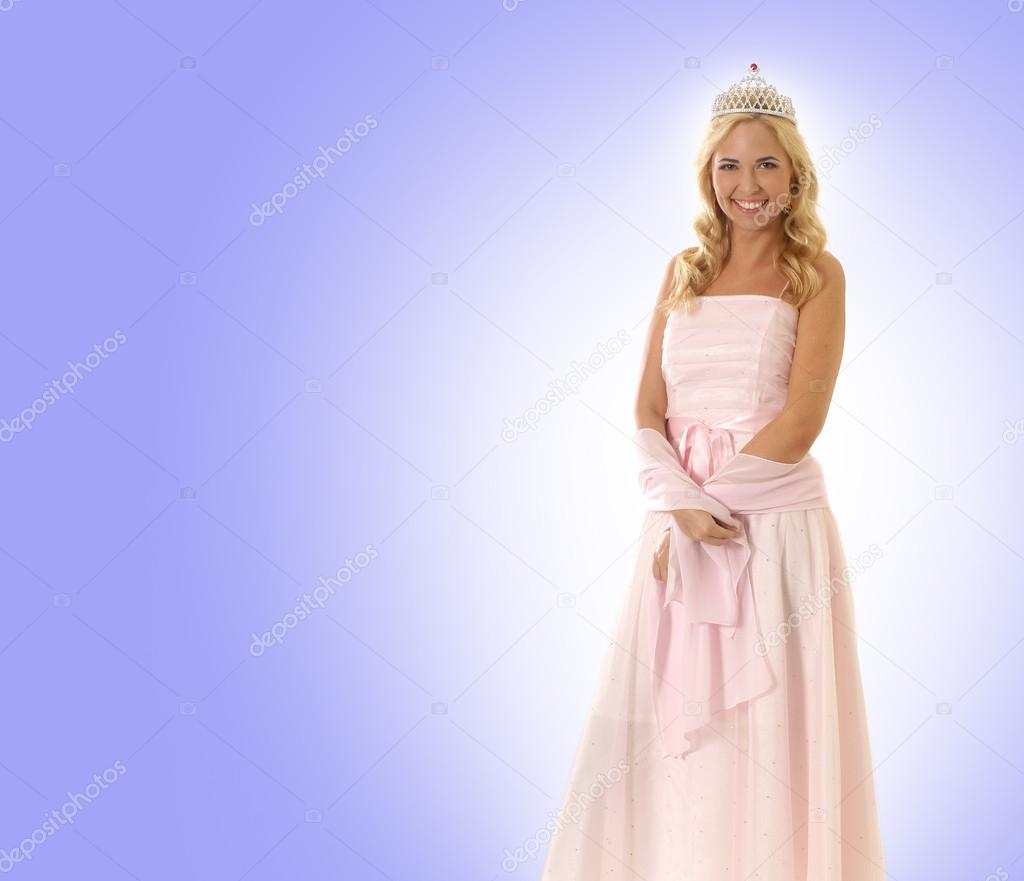 Young beautiful princess isolated on blue — Stock Photo #15872449