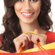 Stock Photo: Young beautiful woman with some shopping bags isolated on white
