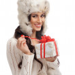 Stock Photo: Young and beautiful woman holding a nice Christmas present over white background