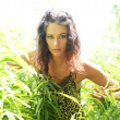 Young and beautiful savage girl in jungle — Stock Photo