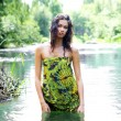 Young and wild woman in jungle - Stock Photo