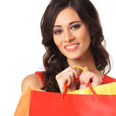 Young beautiful woman with some shopping bags — Stock Photo