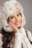 Portrait of young beautiful girl in winter style isolated on white — Stock Photo