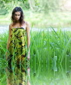 Young and wild woman in jungle — Stock Photo
