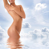 Beautiful body over sky background — Stock Photo