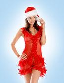 Jonge sexy santa zittend op een grote geschenk geïsoleerd op wit — Stockfoto