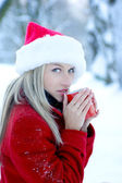 Portrait of a young blond girl drinking hot coffee — Stock Photo
