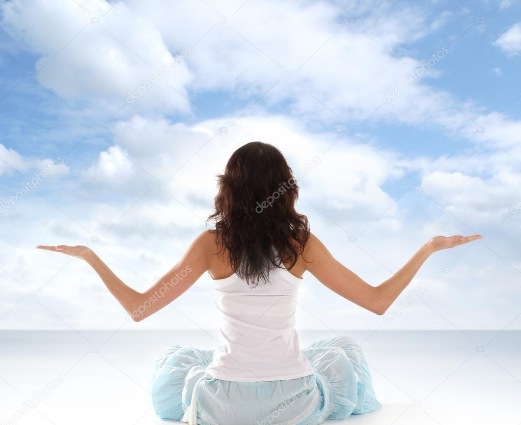 Young fit brunette meditating isolated on white                  Stock Photo #15880865