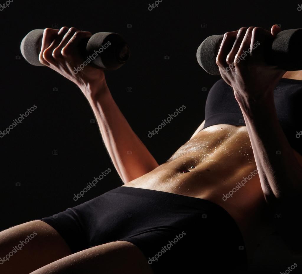 Young sporty woman training with the dumbbell — Stok fotoğraf #15885789