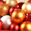 Photo: Christmas background with the balls and snowflakes