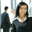 Attractive business woman and her team — Stock Photo