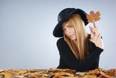 Attractive widow in autumn concept over grey background — Stock Photo