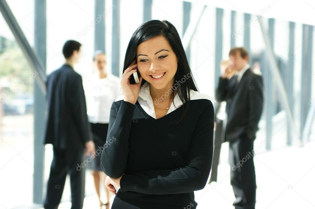 Business in office (WARNING! Focus only on the lady in front of image) — Stock Photo #16020675