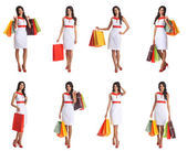 Some photos of young attractive woman with shopping bags — Stock Photo