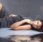 Sexy lady over smoky background — Stock Photo
