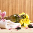 Bottle of massaging oil over spa background — Stock Photo #16049397