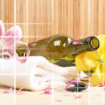 Bottle of massaging oil over spa background — Stock Photo #16165439