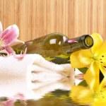 Bottle of massaging oil over spa background — Stock Photo #16165989