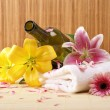Bottle of massaging oil over spa background - Stock Photo