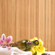 Bottle of massaging oil over spa background — Stock Photo #16166577