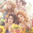 Fashion shoot of young beautiful nymphs in the spring forest — Stock Photo