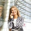 Woman talking on the phone — Stock Photo #16169589