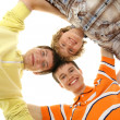 Group of smiling teenagers staying together and looking at camera  — Stock Photo #16169707