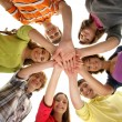 Group of smiling teenagers staying together and looking at camera — Stock Photo #16169723