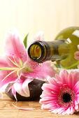 Bottle of massaging oil over spa background — Stock Photo