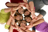Group of smiling teenagers staying together and looking at camera — Foto Stock