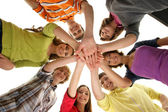 Group of smiling teenagers staying together and looking at camera — Stock Photo