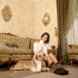 Attractive woman with the dog — Stock Photo #16172421