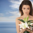 Young lovely woman with lily flower — Stock Photo #16172729