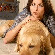 Stock Photo: Attractive womwith labrador dog laying on flor