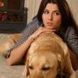 Attractive woman with the dog — Stock Photo #16173105