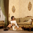 Stock Photo: Attractive womwith labrador dog in luxury interior